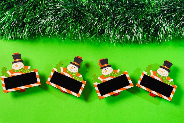 Green christmas with bell, candle, gift box, little snow man