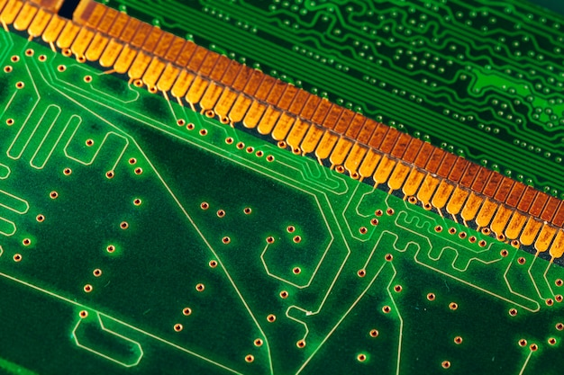 Green circuit board of a computer close up