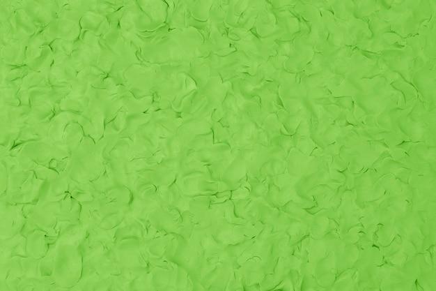 Argilla verde con texture di sfondo colorato fatto a mano arte creativa stile astratto