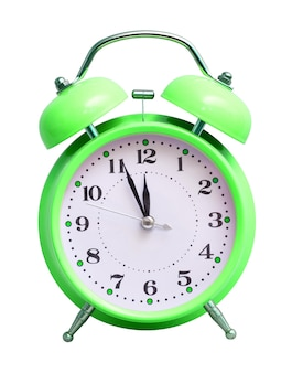 Green clock on white isolated, which shows the approximate 12 hours