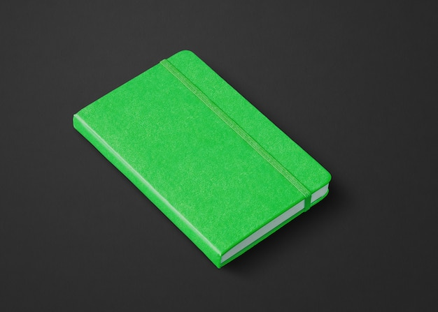 黒で隔離の緑の閉じたノートブックのモックアップ