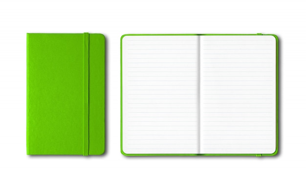 Green closed and open lined notebooks isolated on white