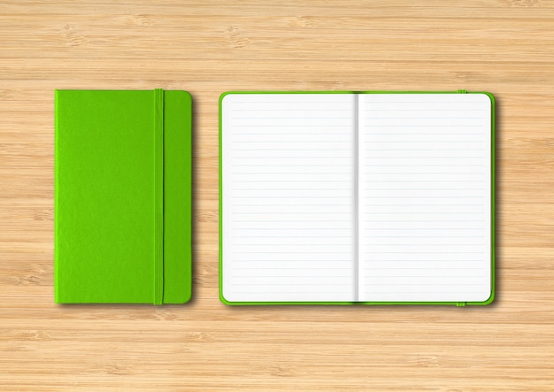 Green closed and open lined notebooks