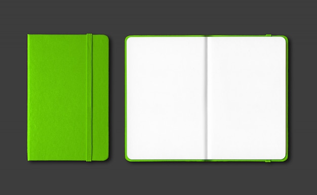 Green closed and open notebooks isolated