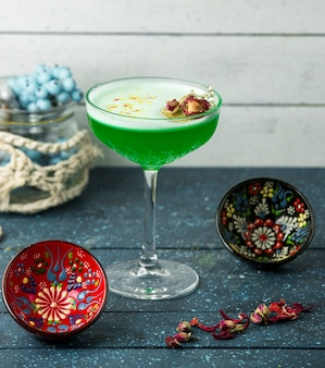 Green cocktail with hazerlnuts on the table