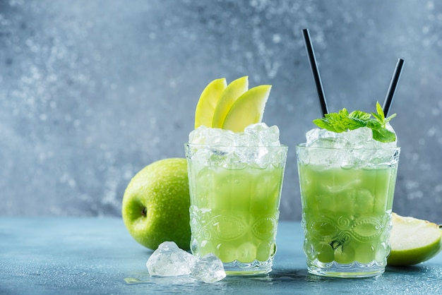 Green cocktail with ice and mint