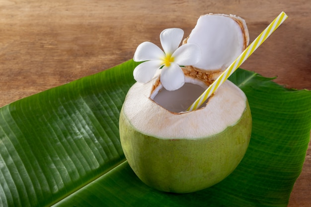 Green coconut fruit cut open to drink juice and eat.