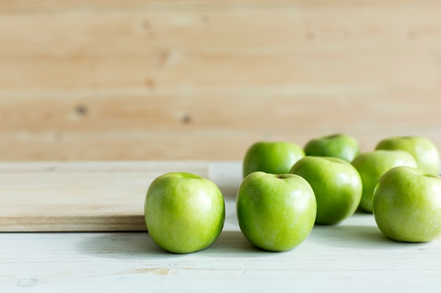 Green color apples on table