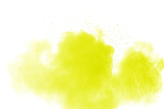 白い背景に緑色の粉の爆発の雲。緑の背景に埃のスプラッシュ。