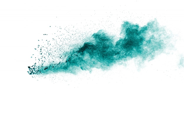 Green color powder explosion cloud on white background
