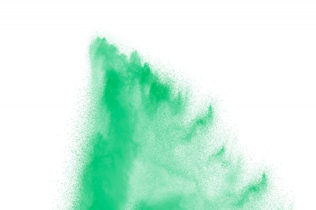 Green color powder explosion on white background.