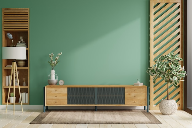 On a green color wall background, a modern living room decor with a tv cabinet.3d rendering