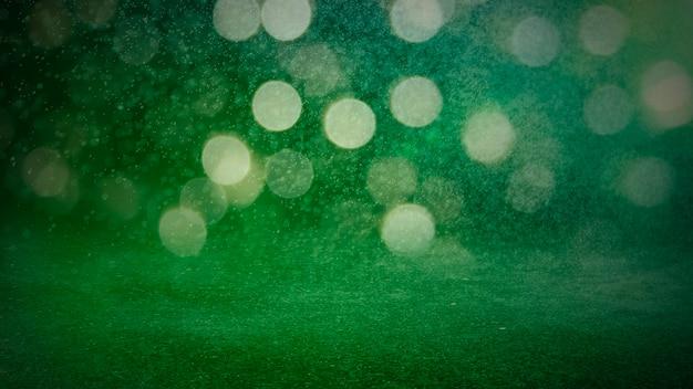Зеленый цвет расфокусированным боке огни фон - горизонтальные обои, плакат. стильный, праздничный и элегантный снимок. модные цвета. освещение, свет, эффекты блеска. праздничное украшение.
