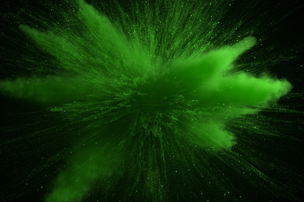 Green colored powder explosion isolated