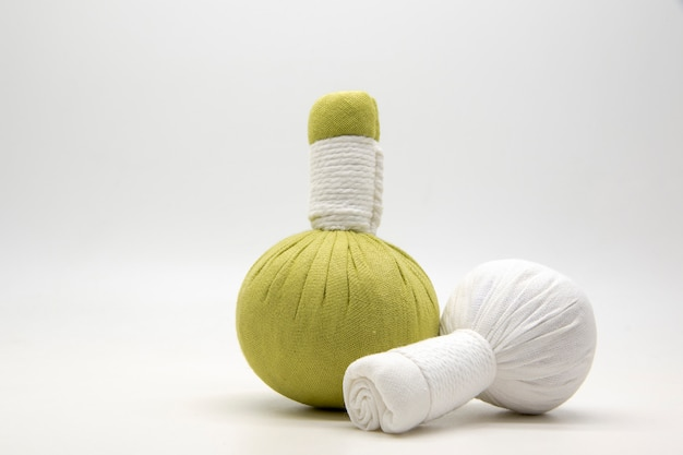 Green compress ball and white compress ball