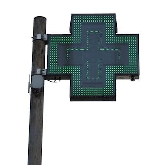 白の上に分離された緑のクロス薬局のサイン