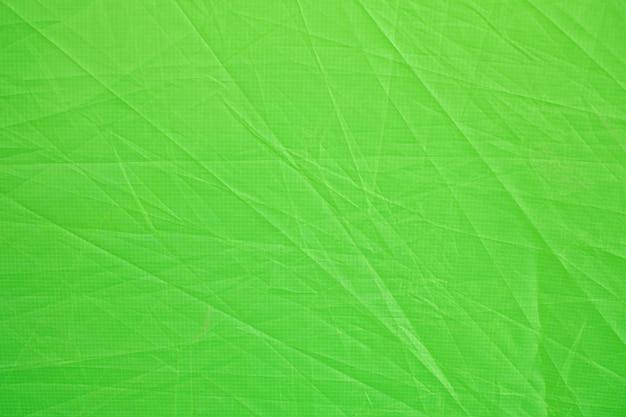 텐트 패브릭 페이지 종이 질감 거친 배경으로 구겨진 녹색. 주름 그런 지 양피지 패턴 포도주 디자인