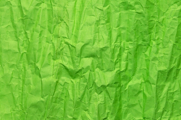 Green crumpled paper texture, grunge background