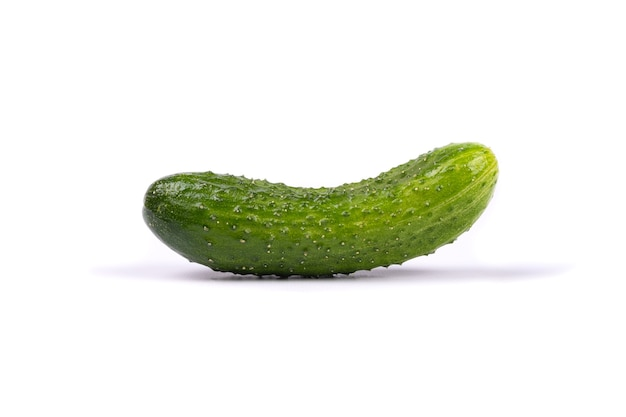 Green cucumber isolated on white wall.