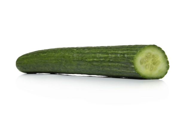 Green cucumber on a white surface