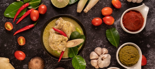Green curry made with chicken, chili, and basil, with tomato, lime, kaffir lime leaves and garlic.