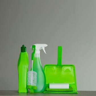 Green detergent bottle for toilet, spray bottle, brush, sponge, scoop and dust. cleaning tools.
