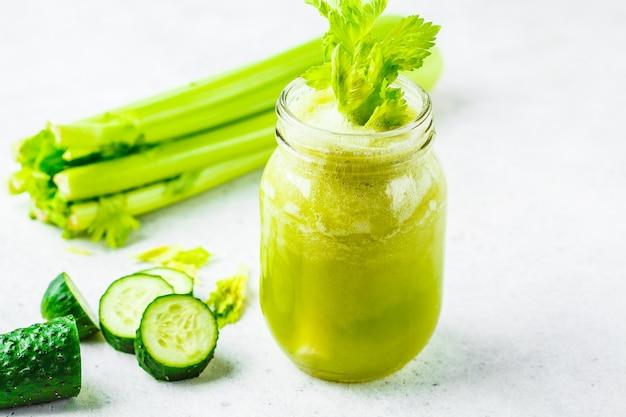 Green detox celery cucumber juice in a jar.