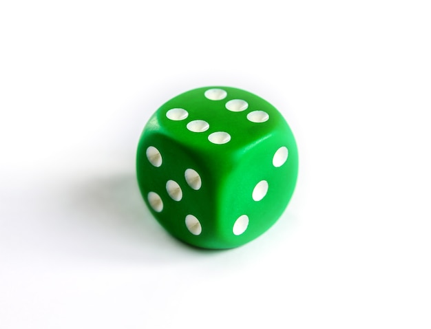 Green dice isolated on white surface. top view