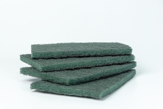 Green dishwashing sponge isolated