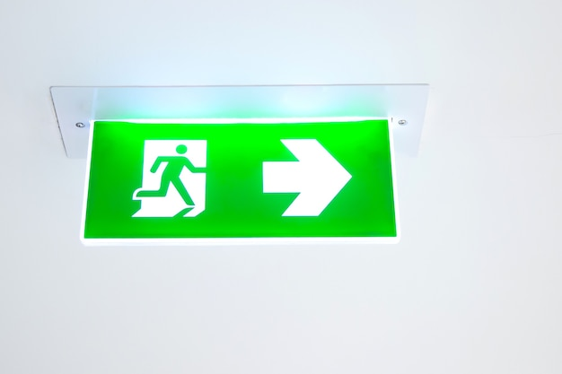 Green emergency fire exit sign or fire escape  in the building
