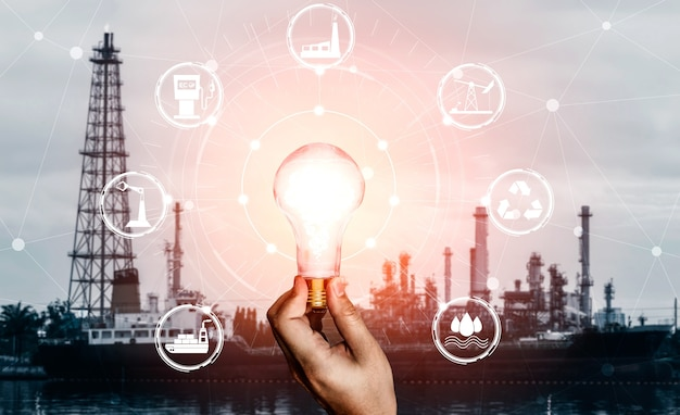 Green energy innovation light bulb with future industry of power generation icon graphic interface