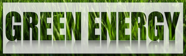 Green energy text on white banner against background of green grass.