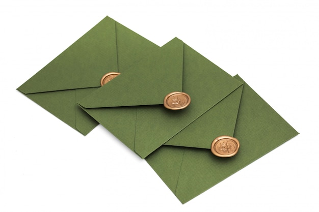 Green envelope with designer cardboard and seal on a white background. envelope with seal