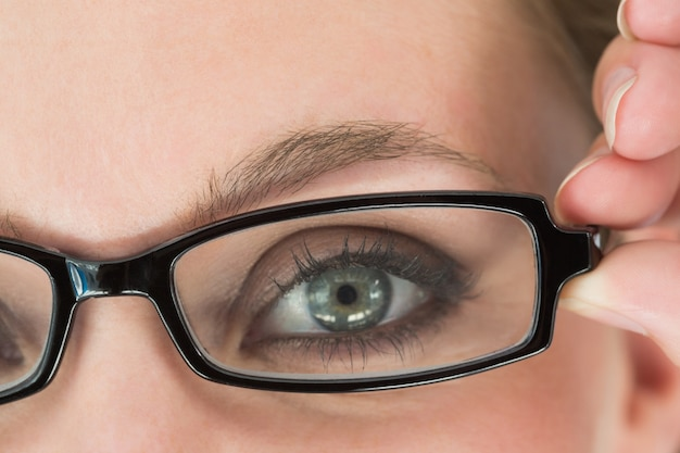 Green eyed woman with glasses