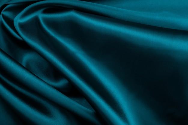 Зеленая ткань текстуры абстрактный фон