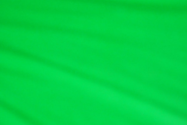 Green fabric texture as background.