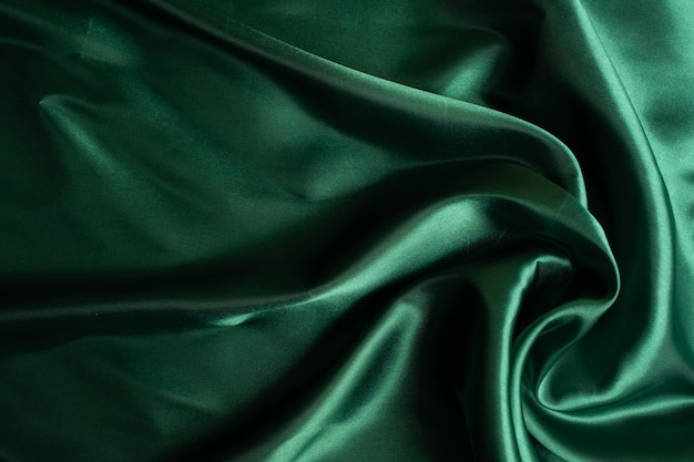 Green fabric texture background, abstract, closeup texture of cloth