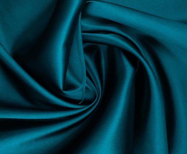 緑の布のテクスチャ背景、布の抽象的なクローズアップテクスチャ