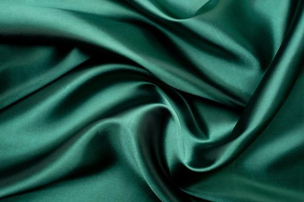 緑の生地のテクスチャ背景、抽象的な、布のクローズアップテクスチャ
