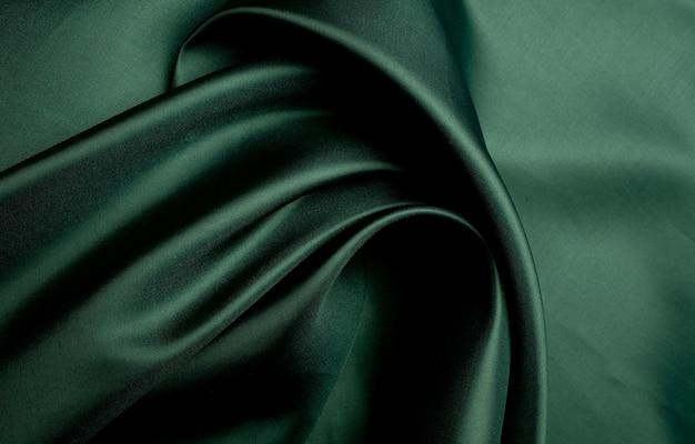 Зеленая ткань текстуры фона, аннотация, крупным планом текстуры ткани