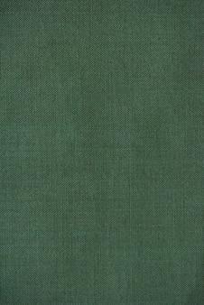 緑の生地のテクスチャ。緑の綿の質感。デザイナーのための綿の質感