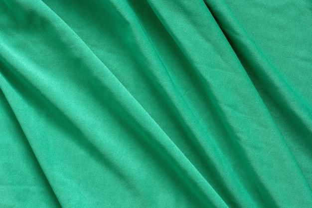 아름다운 대각선 파도와 녹색 패브릭 질감