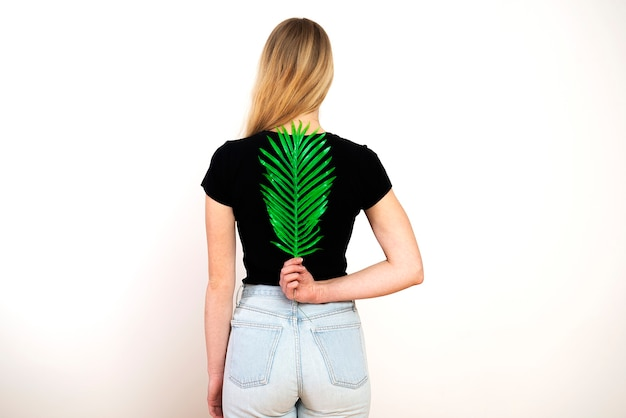 Green fern on female back,spine and female health concept