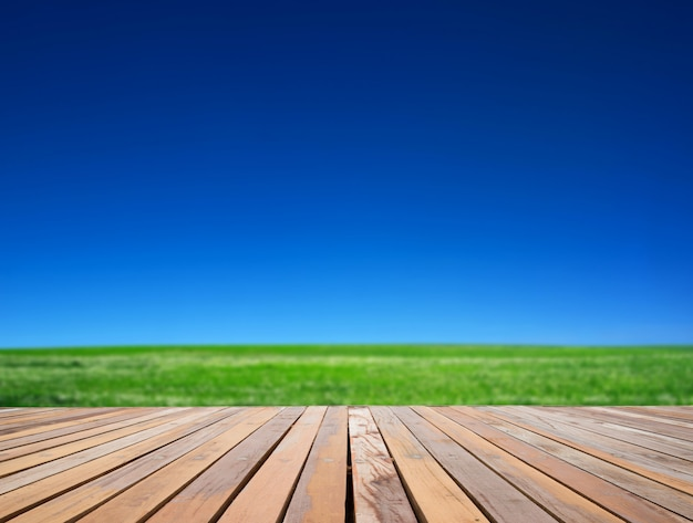 Green field with wooden surface