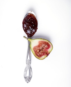 Green fig with jam on white