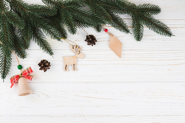 Green fir tree branches with wooden toys