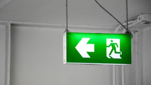 Green fire exit sign in the building