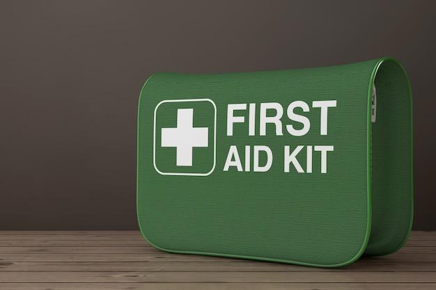 Зеленая мягкая сумка для аптечки с белым крестом на деревянном столе. 3d рендеринг