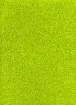 Зеленая флисовая фоновая текстура. крупным планом вид
