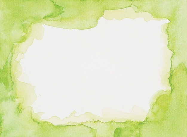 Green frame of paints on white sheet